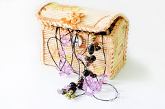 Various women's beautiful jewelry in a wicker box Royalty Free Stock Photo