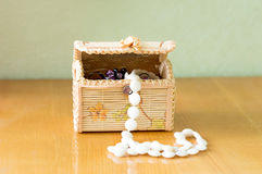 Various women's beautiful jewelry in a wicker box Stock Images