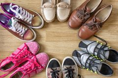 Various women`s shoes and sneakers stand in the form of a circle with a free space in the middle royalty free stock photography