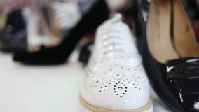 Various women`s shoes in a store. Close up rotation sliding shot of various women`s shoes in a store stock footage