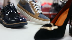 Various women`s shoes in a store. Close up rotation sliding shot of various women`s shoes in a store stock video footage