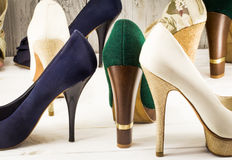 Various womens shoes on wooden background Royalty Free Stock Photography