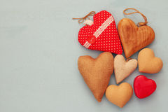 Various of wooden and fabric hearts Stock Photos