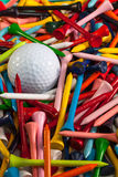 Various wooden golf tees and golf ball Stock Image