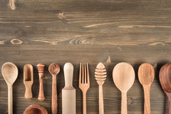 Various wooden kitchen utensils on table. Top view with copy space Stock Image
