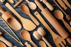 Various wooden kitchen utensils. On table stock photo