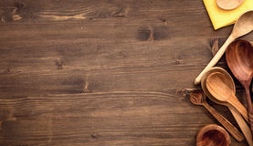 Various wooden spoons at right of wooden table background Royalty Free Stock Photography
