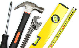 Various work tools on white background. Royalty Free Stock Image