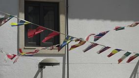 Various world flags flying on ropes. Various world flags flying on the ropes stock video footage