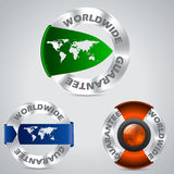 Various worldwide metallic guarantee badges. With color ribbons Royalty Free Stock Photo