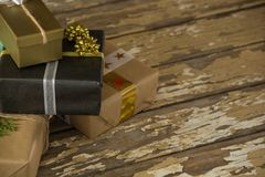 Various wrapped gift box on wooden table Royalty Free Stock Image