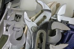 Various wrenches. Various types of wrenches laying on a white surface Royalty Free Stock Photo