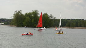 Various yachts and boats on  lake. Various yachts and boats on spring lake stock video footage