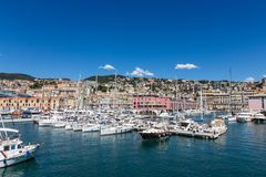 Various yachts, boats and ships in the port of Genoa, Italy stock photos