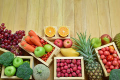 Variouse fresh fruits and vegetables in wooden container with copy space Royalty Free Stock Photos