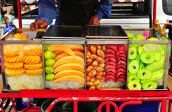 Varity of topical fruit in fruit seller cart Stock Photography