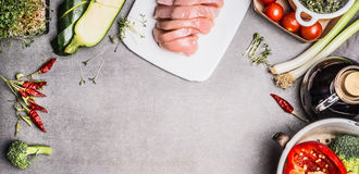 Variuos Healthy or diet cooking ingredients with raw sliced chicken breast and gut vegetables on gray stone background, top view, Stock Photos