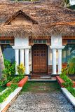 Big bungalow with columns white exterior entrance in the tropical resort. Varkala, India - February 09, 2016: big luxury bungalow with columns white exterior Royalty Free Stock Image