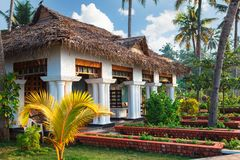 Big bungalow with columns white exterior entrance in the tropical resort. Varkala, India - February 09, 2016: big luxury bungalow with columns white exterior Stock Photo