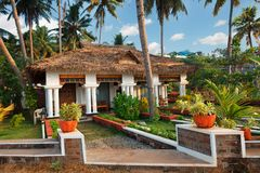 Big bungalow with columns white exterior entrance in the tropical resort. Varkala, India - February 09, 2016: big luxury bungalow with columns white exterior Royalty Free Stock Photo