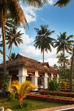 Big bungalow with columns white exterior entrance in the tropical resort. Varkala, India - February 09, 2016: big luxury bungalow with columns white exterior Stock Photography