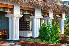 Big bungalow with columns white exterior entrance in the tropical resort. Varkala, India - February 09, 2016: big luxury bungalow with columns white exterior Stock Photos