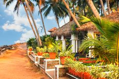 Big bungalow street in the tropical resort. Varkala, India - February 09, 2016: big luxury bungalow street in the tropical resort, palm tree alley, idylic place Stock Photography