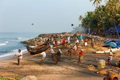 Fishing net with many fishermen on backside. Odayam beach, Varkala, India. Varkala, India - February 09, 2016: Fishing net with many fishermen on backside the stock photo