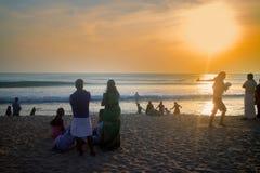 VARKALA, KERALA, INDIA - DECEMBER 15, 2012:. VARKALA, INDIA - Jan 2, 2016: Indians with their families on beach at sunset, swimming royalty free stock image