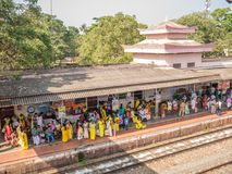 Varkala train station, Kerala, India. 12/31/2017. Varkala, Kerala, India. People wait patiently for their train at one of Kerala`s busiest train stations royalty free stock photo