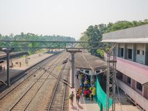 Varkala train station, Kerala, India. 12/31/2017. Varkala, Kerala, India. People wait patiently for their train at one of Kerala`s busiest train stations stock images