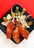 Varkenskotelet en Ribben met Salade Rinforzo Stock Afbeelding