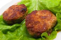Varkenskotelet met groenten stock afbeeldingen