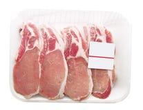 Varkenskoteletten die in een container worden verpakt Stock Fotografie