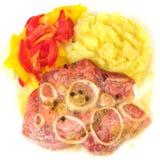 Varkensvlees, aardappels en peper. Stock Afbeelding