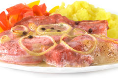 Varkensvlees, aardappels en peper. Stock Fotografie