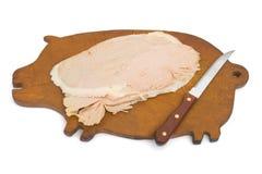 Varkensvlees en mes aan boord Royalty-vrije Stock Foto's