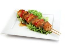 Varkensvlees op een grillspit Stock Foto's