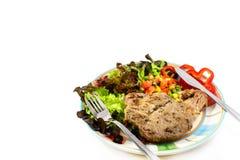 Varkensvleeslapje vlees met groente royalty-vrije stock foto's