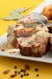 Varkensvleesribben met mosterd en een vork Stock Foto's