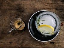 Varm espressoskott och citronsodavatten Fotografering för Bildbyråer