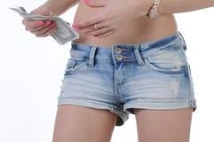 Varm flickaröv med kontanta dollar Arkivbild