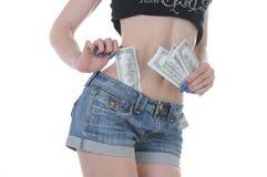 Varm flickaröv med kontanta dollar Fotografering för Bildbyråer