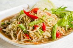 Varm och kryddig papayasallad för thailändsk mat Arkivbild