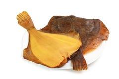 Varm rökt plattfisk två på plattan Royaltyfri Fotografi