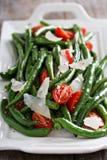 Varm sallad med haricot vert och parmesanost Fotografering för Bildbyråer