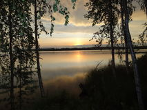 Varm sommarsolnedgångafton i Finland Royaltyfri Bild