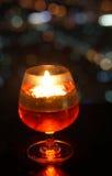 Varm stearinljus ljus på den glass bollen Fotografering för Bildbyråer