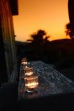 varm stearinljussolnedgång Arkivbild