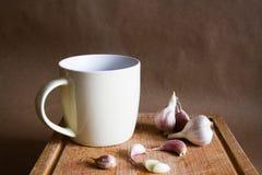 Varm te och vitlök Arkivbild